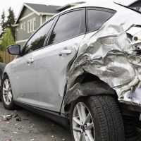 after effects of a serious car crash with damaged brake light