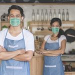 waitress using digital tablet and wear face masks