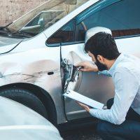 Man hand documant and car crash accident