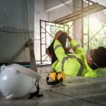 Knee accident at work of construction worker at site. Builder accident falls scaffolding on floor, Electric suction, Unsafe in work concept. Add zoom filter effect for feelings.